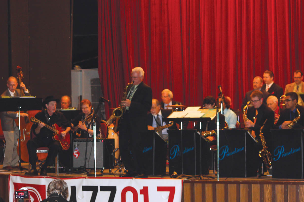 "Guitarist Jackie King (seated far left)performs with the UIW Jazz Ensemble, John Magaldi's Prime Time Jazz Orchestra, Butch Miles, John Panzarella, and Jim Waller during ""A Night of Jazz on Broadway."""