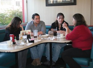 Pictured (L-R) Mary Goodhue, executive assistant of Trey's House; Trey Ibarra, executive director of Trey's House; Trey Griffith; and Maggie Griffith, founder of Trey's House; meet for a strategy session on Friday, Jan. 13.