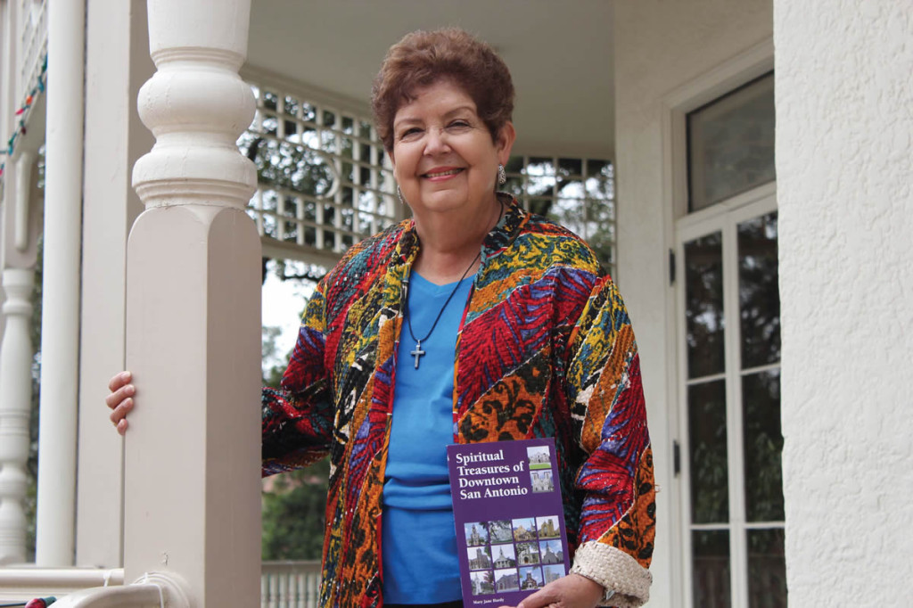 "Mary Jane Hardy, holding her book ""Spiritual Treasures of Downtown San Antonio,"" poses for a photo at the Brackenridge Villa on the UIW campus."