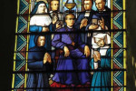 A stained glass tribute to Bishop Claude Marie Dubuis in the parish church in the village of Coutouvre, France.