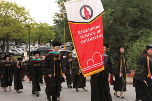 RSO graduates of the inaugural class follow a procession on campus for the spring commencement.