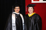 Amalia (left) and Amanda (right) Long pose for a photo during the Spring 2014 UIW commencement held at Joe and Harry Freeman Coliseum.