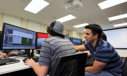 Tovar instructs a student during a 3-D animation class.