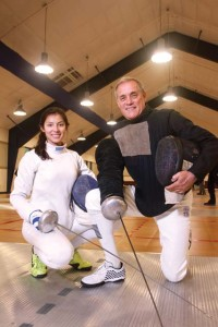 Monet and John pose at the Henrich Center for Fencing and International Sports.