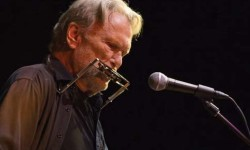 Kristofferson performs during the Helping Hands event.