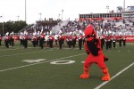 The Marching Cardinals and Red perform during the first football game of the 2015 season.