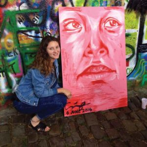 cassidy-w-painting-in-prague-lennon-wall
