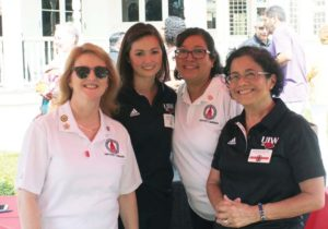 Jinks (left) joins fellow employees at the kickoff event.