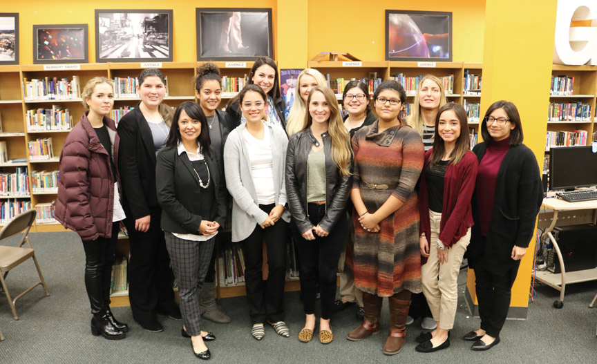 Dr. Elda Martinez, third from left, and her education class at an education symposium.