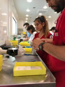 Students from the Rosenberg School of Optometry painstakingly work on corrective eyeglasses in their mobile unit during an ARISE health mission trip to the Rio Grande Valley last year. RSO students and volunteers assisted hundreds of patients with eye exams and provided eye health information.