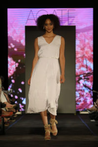 model in white dress at the Cutting Edge Fiesta Fashion Show