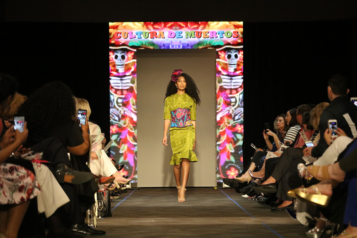 model walks the runway at the Cutting Edge Fiesta Fashion Show
